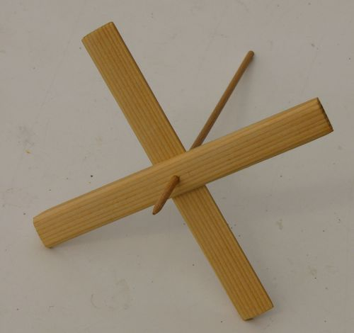 Homemade turkish spindle from a piece of dowel and two pieces of wood pushed onto it to form a cross