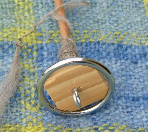 Homemade top-whorl spindle with metal ring