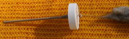 Home-made top-whorl spindle from plastic lid
